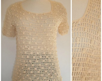 70s boho crochet top. Festival top, breathable, sexy, great with a tan top. Knotted crochet top in natural off white. Size S-M.
