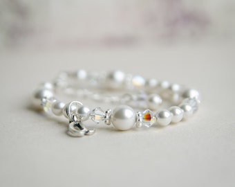 Baby bracelet with an initial ....white baby flower girl communion baptism christening  pearl and crystal girl toddler child bracelet