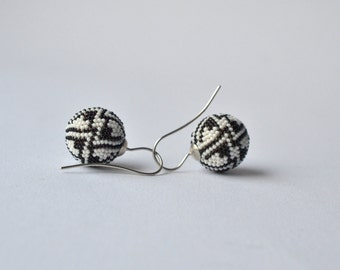 ornamental globe earrings  black and white  glass beads and silver by DONAULUFT