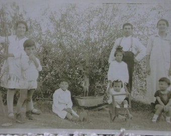 Young Latino Family with 6 Children - Toy Wheelbarrow - Tub - Real Photo Postcard - 1926