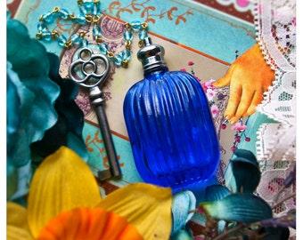 the erzulie bottle number 2- natural perfume oil held in lavish blue bottle w/chain & skeleton key- over 60 victorian inspired aroma option