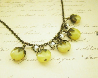 Petite white swarovski pearl bell flowers necklace, yellow coin jades,brass leaf bead cap, woodland, rustic, earthy