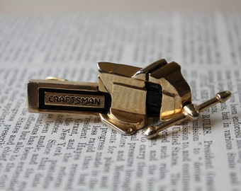 Fantastic vintage Craftsman bench vice brass tie clip with spinning arm. Made by Anson.