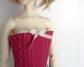Pink lace-up vinyl bustier with ivory bow, lace & topstitching for SD 13 ball-jointed dolls