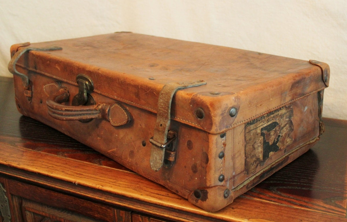 Antique well traveled leather suitcase - Vintage suitcase ...