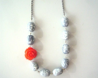 White grey flower necklace with a red rose