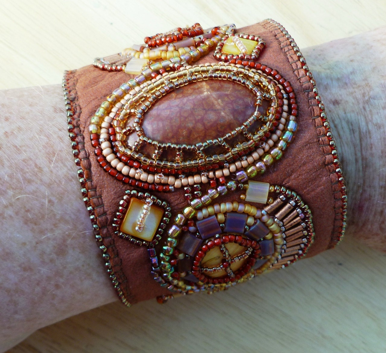 Tan leather bead embroidered cuff
