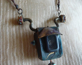 Rosaritaville's The Nautilus Chamber...a necklace for your inner mermaid