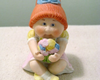 Vintage Ceramic Cabbage Patch Kid Girl With Flowers