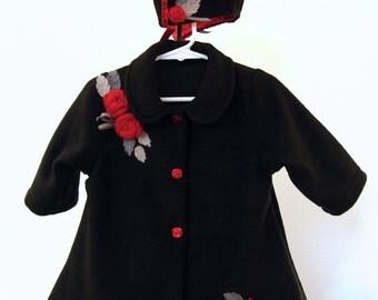 Heirloom black fleece baby infant coat. Beautiful, rich red roses on black fleece.