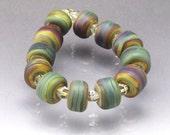 Handmade beads Raku bead set Small barrel beads Raku spacers Brown beads Small beads Earthy beads Raku lampwork glass beads Anne Londez  SRA