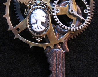 "Steampunk Key Pendent withClock Gears, Cameo and Crown, 5"" in length"