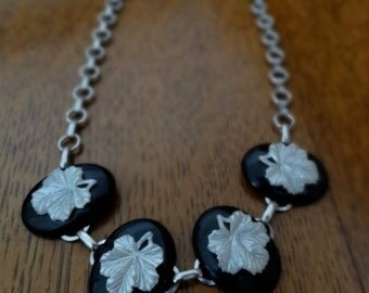 Necklace choker white leaves on black plastic ovals cameo look on silver tone chain shabby chic