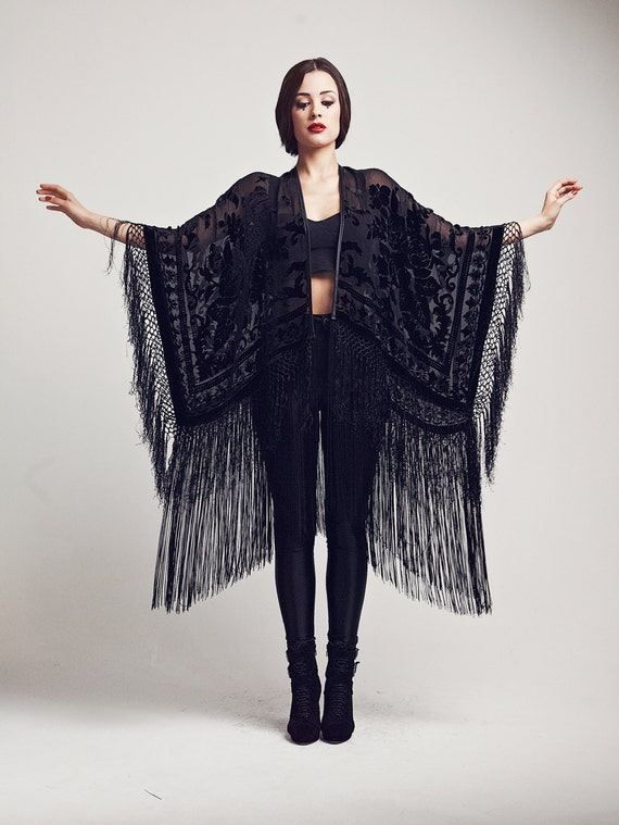 Slip into something comfortable at the end of a long day at work and choose a fringed kimono. Sultry and sensuous, this style of kimono is the ultimate in feminine luxury with its long fringe that decorates the sleeves and flowing hemline.