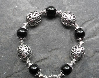 Black onyx  silver filigree bracelet featuring genuine black onyx gemstones and silver filigree beads 7 1/2""