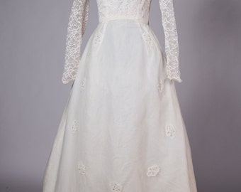 Classic 1960s wedding dress with beaded applique and attached crinoline for a full skirt