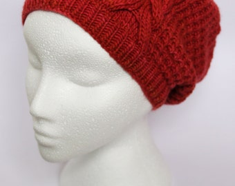 Slouchy hat knit in red merino wool with single cable