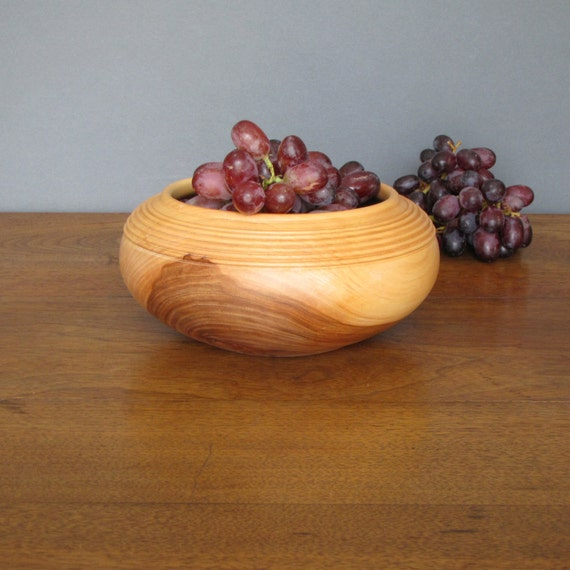 Wooden salad bowl turned from apple wood, salad plate or salad server with golden tan to deep brown colors