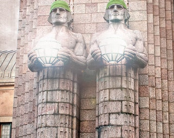 "Twin statues at Helsinki railway in Finland 8""x8"" photograph."