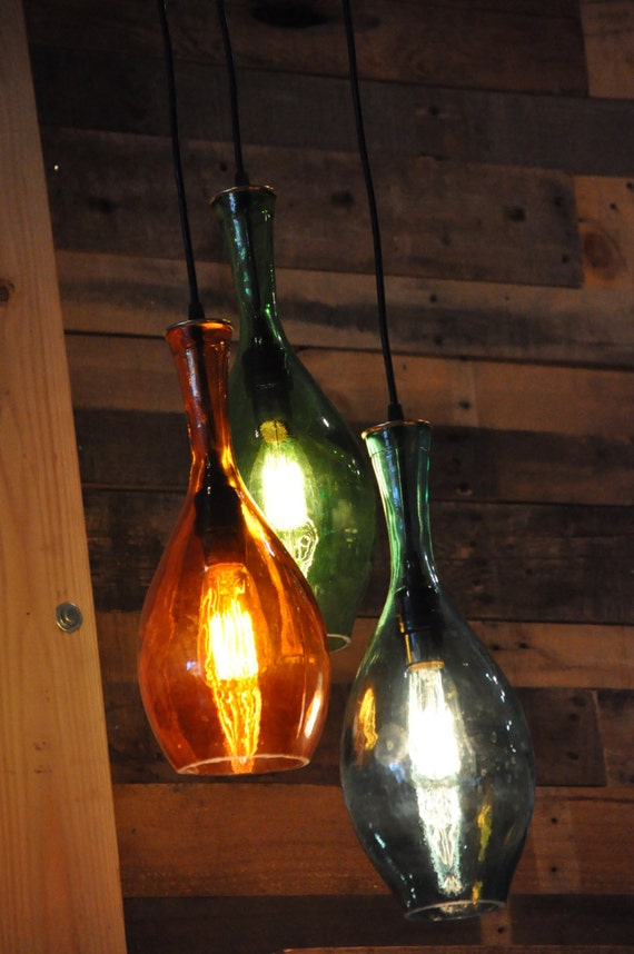 Items similar to hanging recycled bottle glass chandelier on etsy - Glass bottle chandelier ...