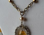 10% off on this item - Shabby chic amber colored glass teardrop pendant inside oval rhinestone setting brass necklace