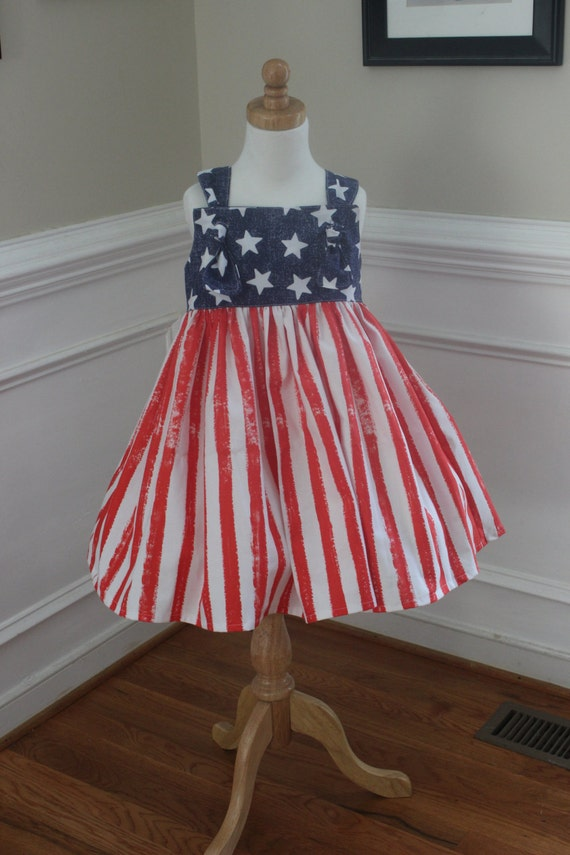 Get a Fourth of July dress that you'll wear all summer long but opting for less literal prints, and varying shades of red, white, and blue.