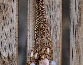 Necklace with lots of dangling charms, chains,and glass beads