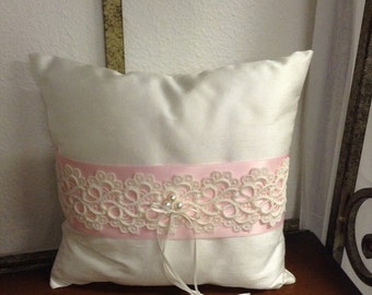 Ring Bearer pillow in white satin with pink ribbon and lace detail