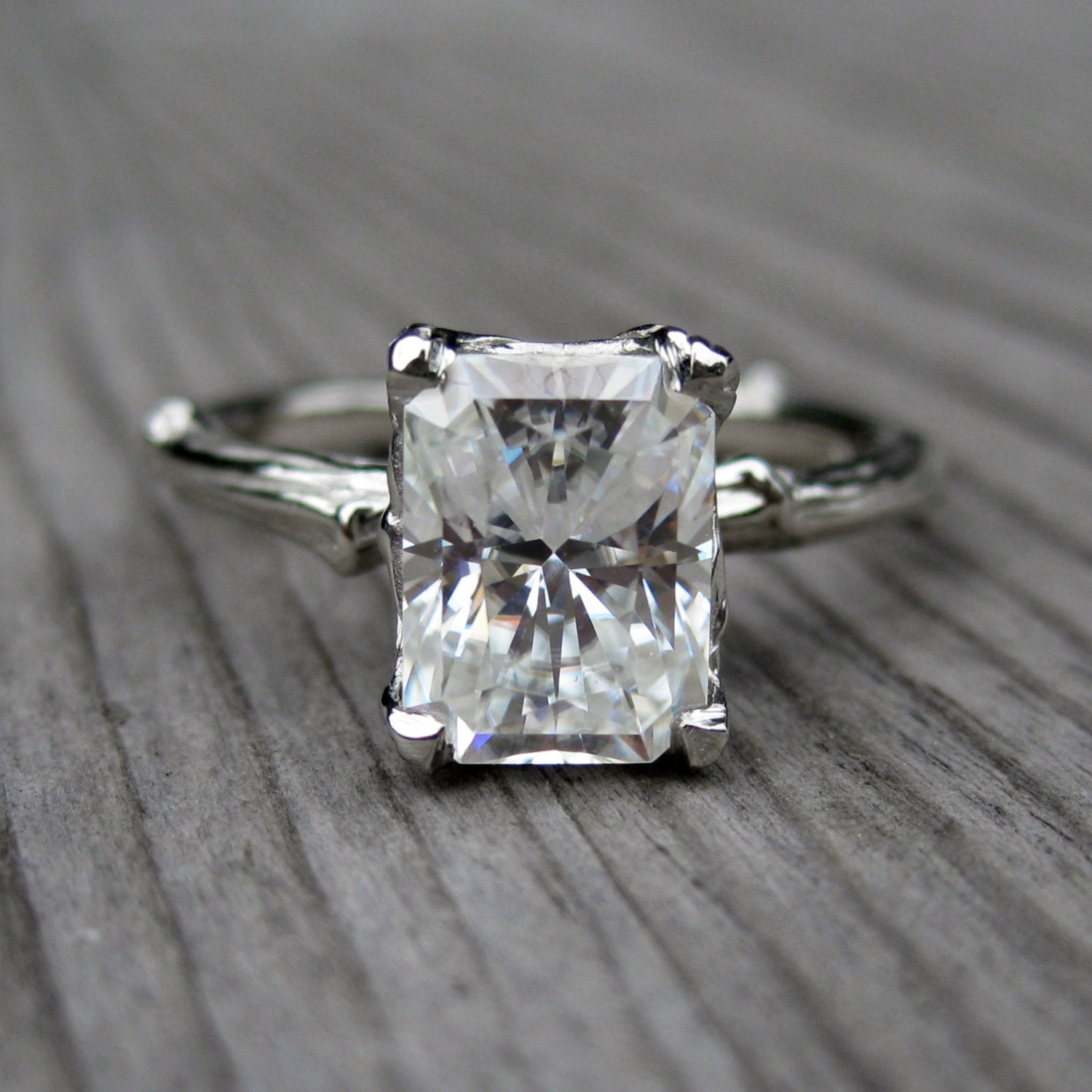emerald moissanite twig engagement ring carved by