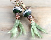 Deep Green Lampwork Earrings With Ribbon Tassels and Spiral Copper Beads