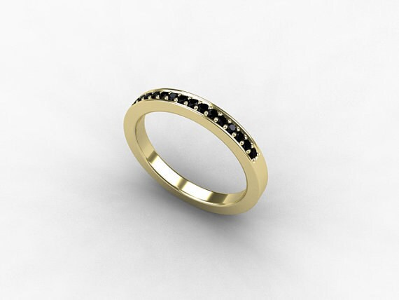 black ring yellow gold wedding band by