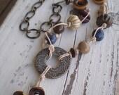 Blue Haze necklace- mixed media blue & cream ceramics.  hemp knotted ceramic jewelry. brass chain. Jettabugjewelry