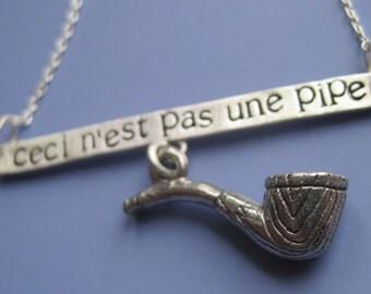 Ceci Nest Pas Une Pipe Necklace
