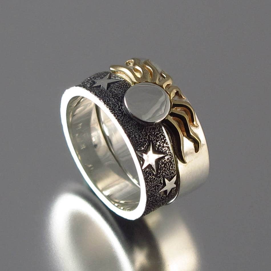 solar eclipse sun and moon engagement ring and wedding band