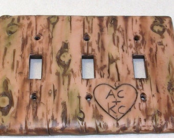 Carved love initials in a Bark of a tree triple toggle light switch cover