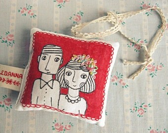 Love (decoration, or ring pillow)