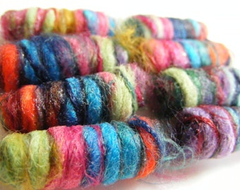 If she'd just add one more color to our mix, we think we'd be perfect. Fiber Bead set, Artisan Jewelry beads, Dread bead, dread lock tube