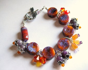 Lampwork & lepidolite chunky charm style bracelet, purple and orange with sterling silver