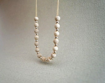 Gold filled necklace with beads.