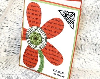 Celtic Flower Birthday Card with greeting in English, Celtic Knots and Gaelic writing patterns, Orange, Green and Black Knotwork