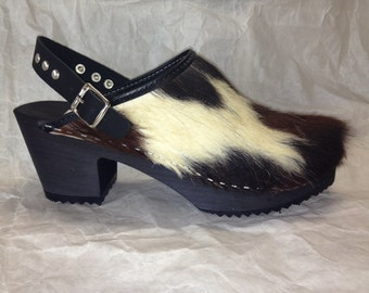 Brown black and cream cowhide medium heel clog with studded ankle strap