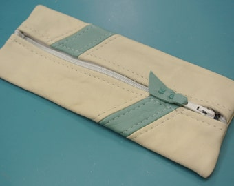 Pen-case of creame white/ turqouise green soft highquality skin/leather with inside lining and strong zipper
