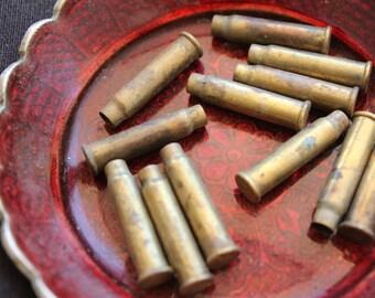 Empty brass bullet shell casings - 27x7mm (12)