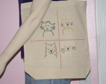 Hand embroidered cats on a cotton tote bag