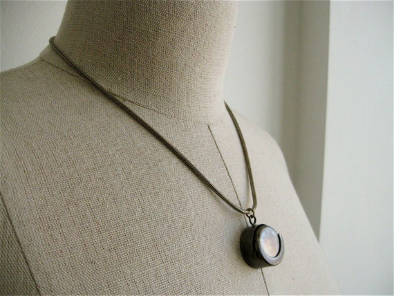 Minimalist Sterling Silver Coin Keeper Necklace.
