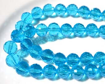 Capri Blue 10mm Multifaceted Crystal Round Beads  25