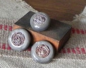 Vintage buttons set of three 1940s grey brown plastic swirly taupe plastic with an inset of a fabric rosette