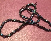 Round, 4mm two tone black and blue czech fire polished, jablonex, beads