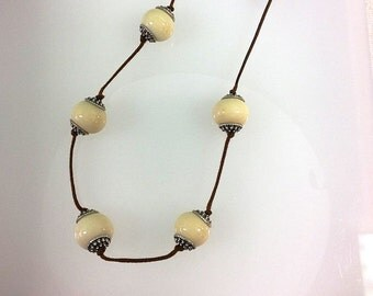 Lamp Work Glass Bead Necklace Ivory Beads on Two Knot Cord