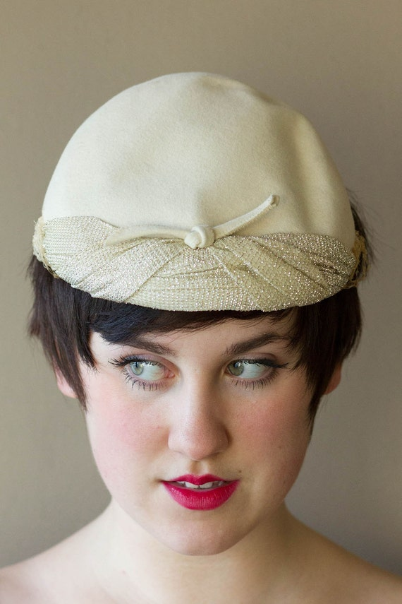 ivory sparkly vintage hat with bow in front and silver embroidery